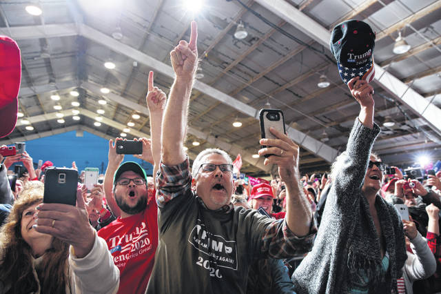Supporters of President Donald Trump cheer as he arrives for a campaign rally, Friday, Oct. 12, 2018, in Lebanon, Ohio.