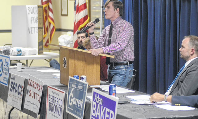 Aden Baker, candidate for Ohio's 82nd House District, speaks to Auglaize Democrats while Joe Monbeck (right), candidate for Ohio's 84th House District, waits to rally voters.