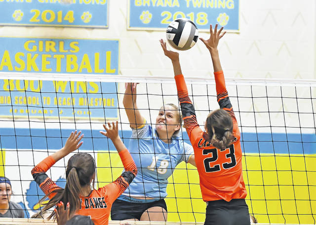 Elida's Kylie Voehees (23) defends against Bath's Mallory Clark during Tuesday night's Division II match at Bath High School.