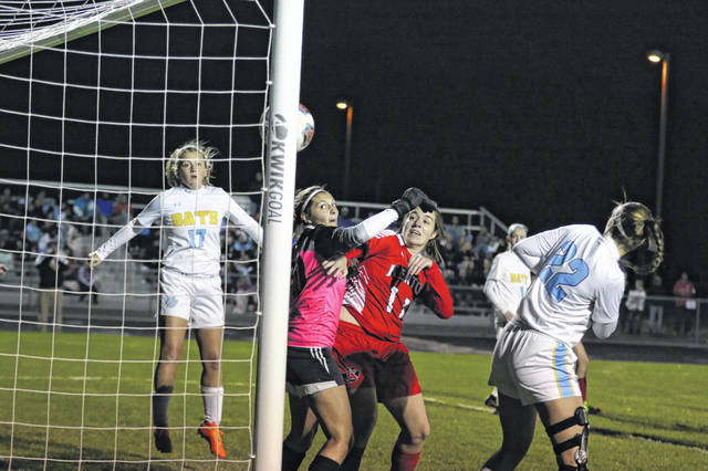 Kenton's Caitlin Tudor, Bath goalie Emily Rocca and Bath's Madison Ward (17) and Jordain Craig (22) watch as the ball heads toward the goal during a Tuesday night Division II district semifinal at Elida.
