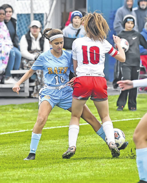 Bath's Jenna Wireman dribbles against Van Wert's Elizabeth Tomlinson during Monday's Division II sectional semifinal match at Bath High School.