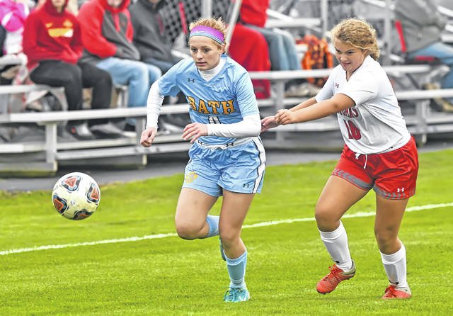 Bath's Chandler Clark dribbles ahead of Van Wert's Liesel Hope Larry during Monday's Division II sectional semifinal match at Bath High School.