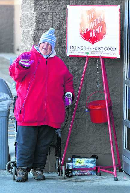 "Clara Long of Lima rings a Salvation Army bell and waves hello to customers entering eastside Wal-Mart on Wednesday. Long has been volunteering for the Salvation Army for the last 24-years, ""I like to help and talk people,"" Long said.  Craig J. Orosz 