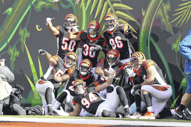 The Cincinnati Bengals defense celebrate a touchdown on an interception by free safety Jessie Bates (30) during the second half of an NFL football game against the Tampa Bay Buccaneers in Cincinnati, Sunday, Oct. 28, 2018. (AP Photo/Frank Victores)