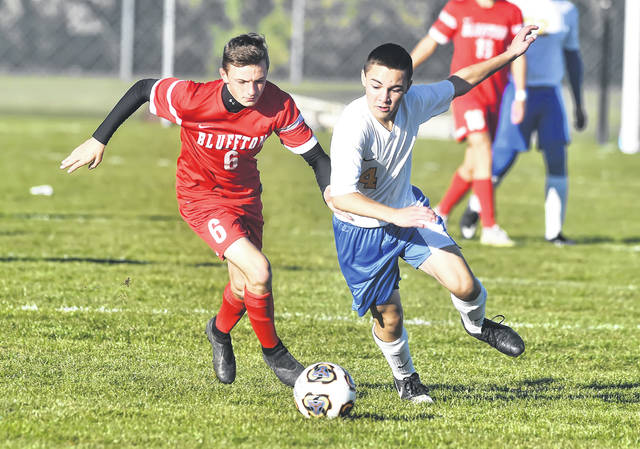 Continental's Wyatt Davis dribbles ahead of Bluffton's Tayton Kleman during Wednesday's Division III district semifinal match at Kalida High School.