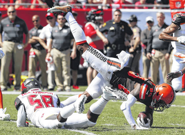 Cleveland Browns wide receiver Jarvis Landry (80) is upended by Tampa Bay Buccaneers outside linebacker Kwon Alexander (58) after a reception during the first half of an NFL football game Sunday, Oct. 21, 2018, in Tampa, Fla. (AP Photo/Mark LoMoglio)