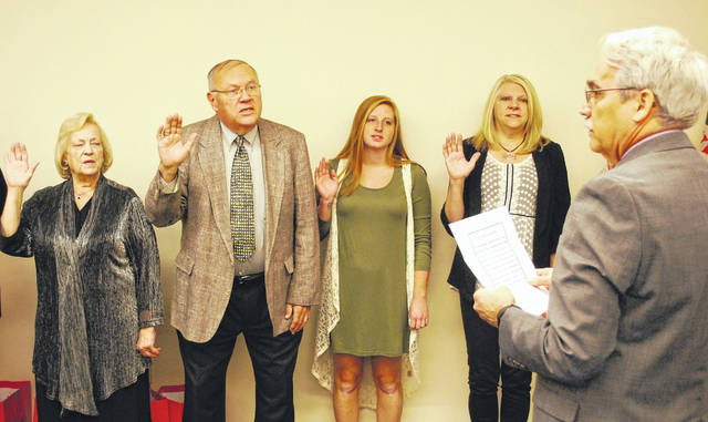 Allen County Juvenile Court Judge Glenn Derryberry issued the oath of office Tuesday to 13 new volunteer advocates of the CASA program — an acronym for Court Appointed Special Advocates for children.