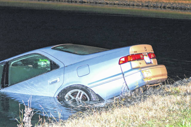 Local authorites respond to a vehicle submerged in a pond. A driver ran the stop sign going north on Brentlinger, went off the side of the road, jumped a hill and came to a rest in the pond on the corner of Brentlinger and Clum Roads in Westminster late Monday night.