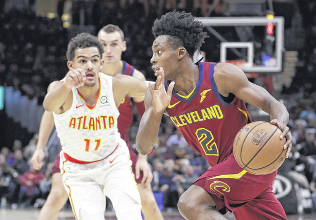 Cleveland Cavaliers' Collin Sexton (2) drives past Atlanta Hawks' Trae Young (11) in the first half of an NBA basketball game, Sunday, Oct. 21, 2018, in Cleveland. (AP Photo/Tony Dejak)