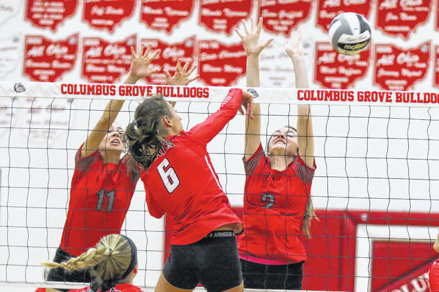 Columbus Grove's Peyton Brubaker (11) and Haley Radabaugh defend against Bluffton's Kylie Stackhouse during Tuesday night's Division IV match at Columbus Grove.