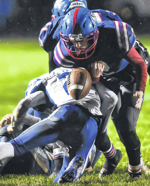 Allen East's Bradden Crumrine, bottom, forces a fumble against Crestview's Kaden Short during Friday night's Northwest Conference game at Crestview. Crumrine also had an 85-yard kick return for a touchdown.
