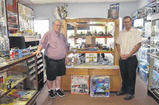 Dad's Toy Shop co-owners J.P. Metz and Rodney Metz show off a railroad track display at the store on 123 W. Auglaize St., Wapakoneat.