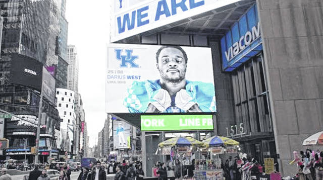 Lima Central Catholic graduate Darius West is one of several University of Kentucky football players appearing on a Times Square video board to promote the Wildcats' game against Georgia on Saturday.