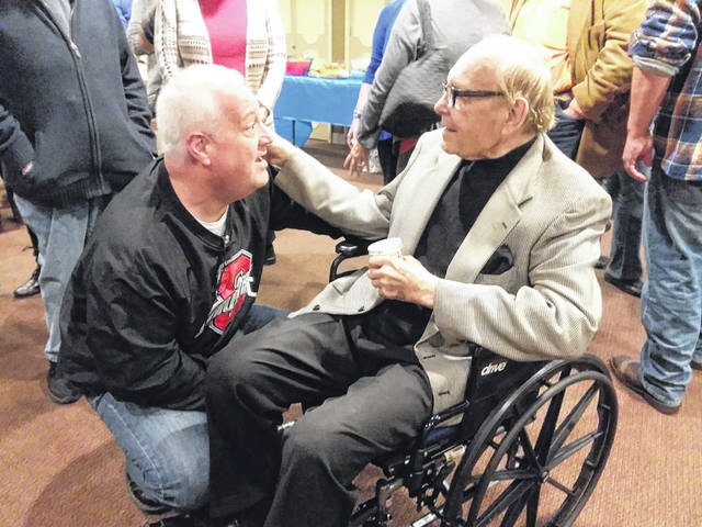 Jeff Fitzgerald swaps stories with George Dunster at an open house for Dunster at Lima's Encore Theatre.