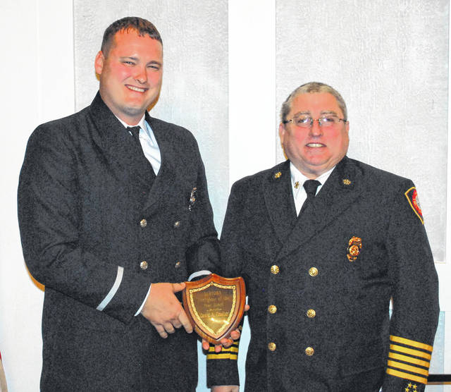 David Coulter, left, a firefighter and paramedic with the Lima Fire Department, was named Firefighter of the Year by the Lima Noon Sertoma Club during a noon ceremony Tuesday. Coulter is pictured with Lima Fire Chief Bruce Black.