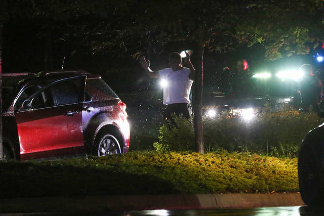 Officers from the Allen County Sheriff's Department respond to a high speed pursuit through Lima early Saturday morning around 1:05 AM. Spike strips were deployed to stop the vehicle, which finally came to a rest in the parking lot of Mercy Health St. Rita's.      Levi A. Morman | The Lima News