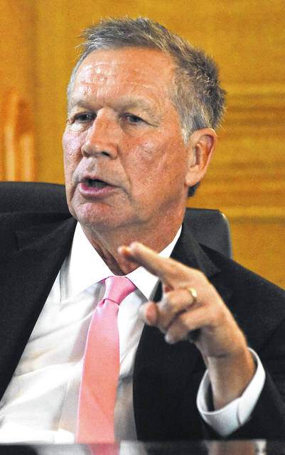 Gov. John Kasich answers questions in his office at the state Capitol in Columbus.