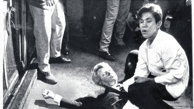 Presidential candidate Robert F. Kennedy lies on the floor at the Ambassador Hotel in Los Angeles moments after he was shot. Juan Romero kneels next to him. Boris Yaro / Los Angeles Times)
