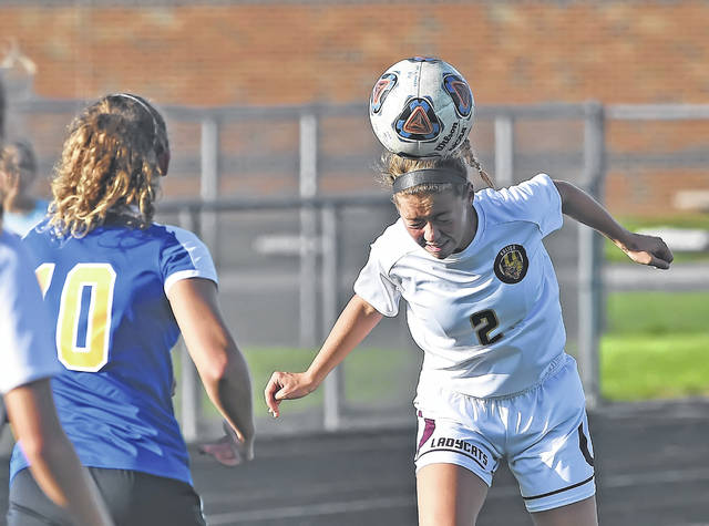 Kalida's Carlie Rampe heads the ball in front of Continental's Maddie Burke during Tuesday's Putnam County League match at Continental High School. See more soccer photos at LimaScores.com.