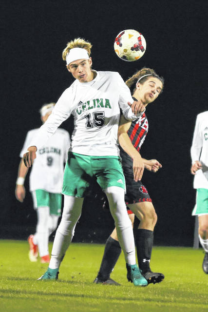 Celina's Cale Schmitmeyer wins the ball over Kenton's Cobe Heydinger on Monday evening during the Division II District semifinal game held at Elida. Kenton shut out Celina, 4-0, to advance to play Shawnee Thursday.