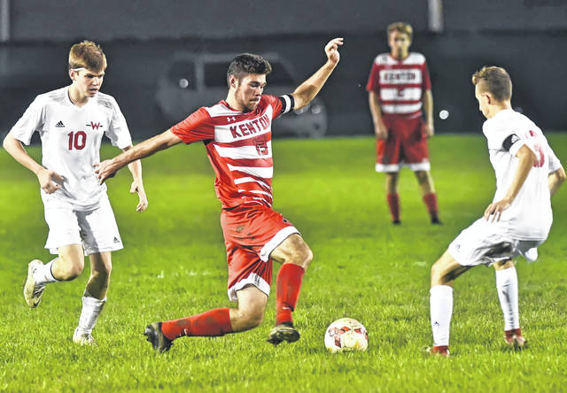 Kenton's Isaac Mendez dribbles against Wapakoneta's Hunter Coffey during Monday's match at Charles S. Merold Field in Kenton. Kenton won the game 1-0 on a Riley Risner goal.