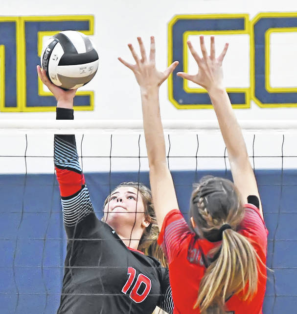 Lima Central Catholic's Kennedy Parker spikes against Columbus Grove's Haley Radabaugh during Monday's Division IV District Semifinal tournament at Robert J. Hermiller Gymnasium in Ottawa. Parker had four aces on the night.