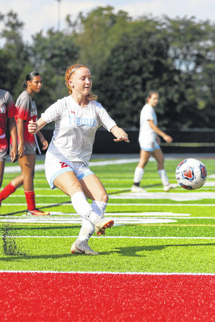 Lima Central Catholic's Annika Wilker takes a shot on goal during Saturday's match at Spartan Stadium.