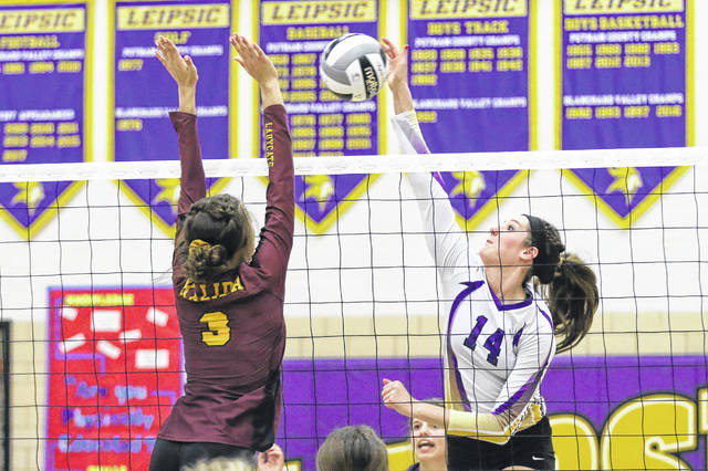 Leipsic's Hayley Heitmeyer hits a shot against Kalida's Lydia Vorst. Heitmeyer reached 1,000 career kills during the match Thursday night at Leipsic.