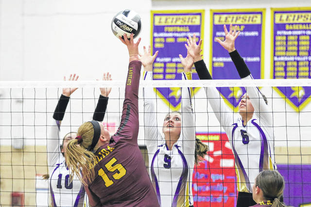 Leipsic's Elizabeth Scheckelhoff (9) and Carlee Siefker (6) go up to defend against Kalida's Emily Buss during Thursday night's match at Leipsic.