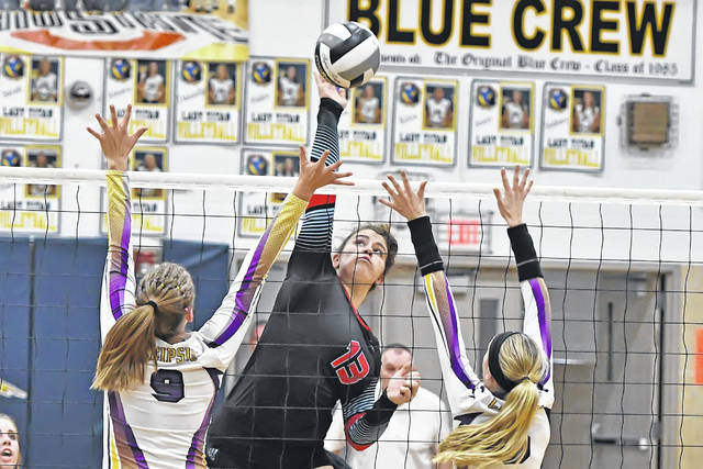Lima Central Catholic's Rosie Williams hits a spike against Leipsic's Liz Sheckelhoff, left, and Peyton Heitmeyer during Thursday's night's Division IV district final at Ottawa-Glandorf's Robert J. Hermiller Gymnasium.