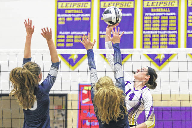 Temple Christian's Lizzie Helser, left, and Jordyn Hayes defend against Leipsic's Hayley Heitmeyer during a Division IV tournament match at Leipsic.