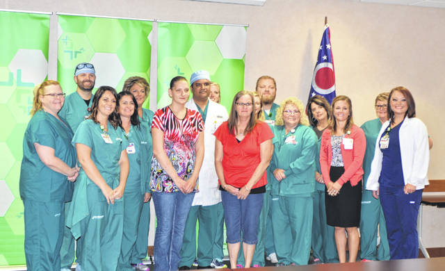 Lima Memorial Health System heart attack survivor Libby McKean is reunited with the Lima Memorial Health System medical staff who saved her life in June 2018 at the Heart Recovery Reunion at Lima Memorial Health System Monday.