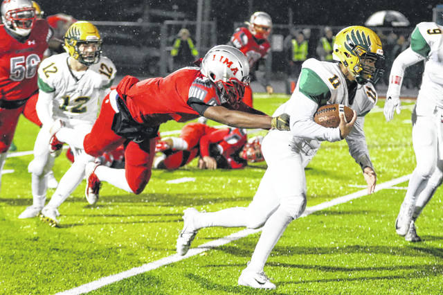 Lima Senior's Rashad Wallace dives to tackle Oregon Clay's Dorian Myers during Friday night's Three Rivers Athletic Conference game at Spartan Stadium.