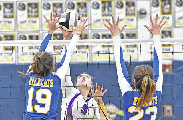Leipsic's Elizabeth Scheckelhoff spikes the ball against Miller City Abi Teders, left, and Katelyn Kuhlman during Monday's Division IV District Semifinal tournament at Robert J. Hermiller Gymnasium in Ottawa. Leipsic won 3-0, 25-10, 25-9 and 25-8. Miller City ends its season with a 14-9 mark. Leipsic advances to the district final against Lima Central Catholic/Columbus Grove.