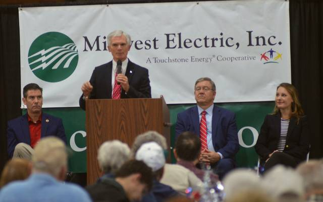 Rep. Bob Latta takes to the podium as state Rep. Craig Reidel (far left) and state Rep. Bob Cupp (right to podium) listen. Republican candidate for Ohio's 84th House District Susan Manchester (far right) also spoke briefly during the event.