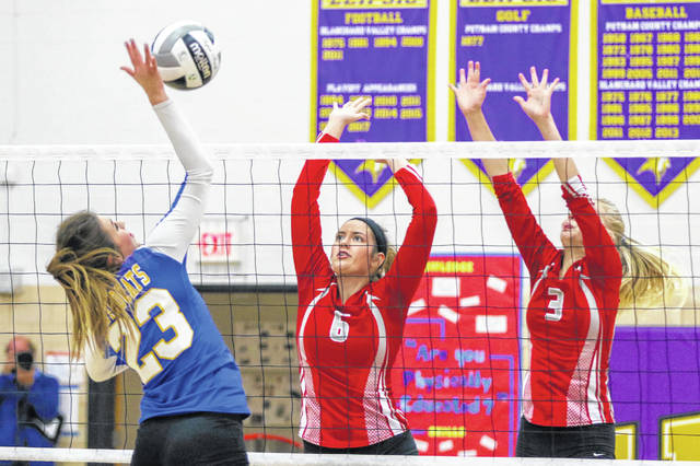 Pandora Gilboa's Makayla Kinsinger (6) and Mikayla Simons defend against Miller City's Katelyn Kuhlman during a Division IV tournament match Thursday at Leipsic. See more volleyball photos at LimaScores.com.