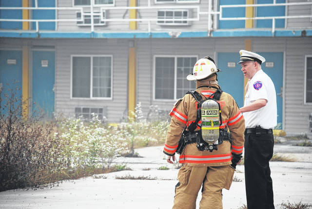 "Bath Fire Chief Joe Kitchen speaks with one of his firefighters who responded to a fire Wednesday morning at the site of the former Lima Inn Motel at 1201 Neubrecht Road. Kitchen said the cause of the first is as yet undertermined but is being considered ""suspicious."""