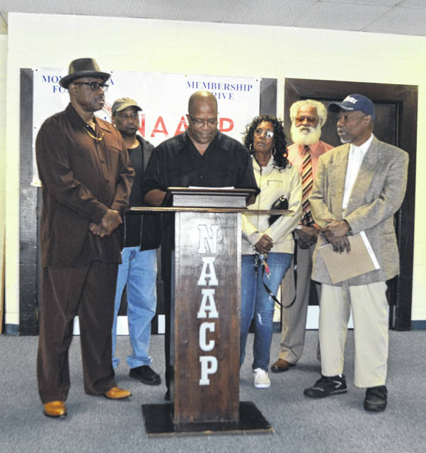 Robert Owens, Steven Riley, Lima NAACP President Ron Fails, Denise Cobbs, Les Henderson Sr. and Pastor Arsben Jennings participate in the Lima NAACP press conference to address support of Issue 1 Tuesday at Grace Church Worldwide Ministries on 2945 Wells Drive.