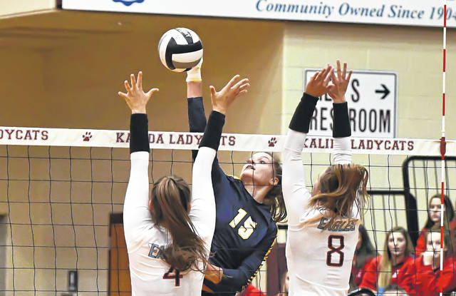 Ottawa-Glandorf's Taylor Alt hits a spike agains Pemberville Eastwood's Ashley Hodulik, left, and Alissa Ray during a Tuesday night Division III district semifinal at Kalida High School. See more volleyball photos at LimaScores.com.