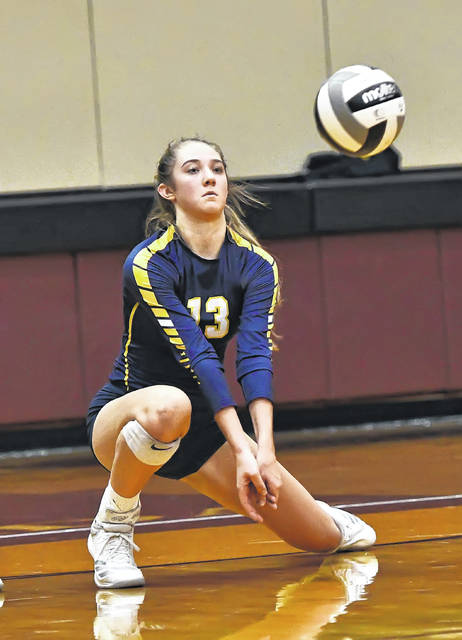 Ottawa-Glandorf's Erica Annesser digs the ball against Pemberville during Tuesday's Division III District Semifinal tournament at Kalida High School.