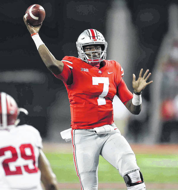 Ohio State's Dwayne Haskins jumps up to make a pass during Saturday's game against Indiana at Ohio Stadium in Columbus.