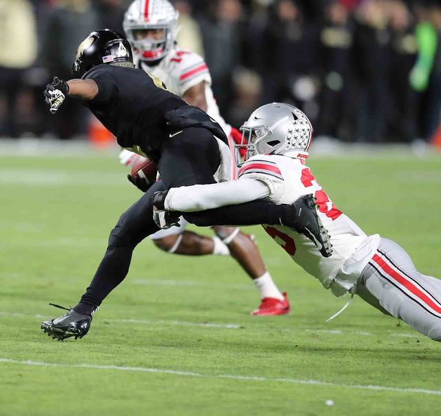 Ohio State's Brendon White *25) wraps up Purdue wide reciever Rondale Moore (5) in the first half at Ross-Ade Stadium on the campus of Purdue University Saturday.