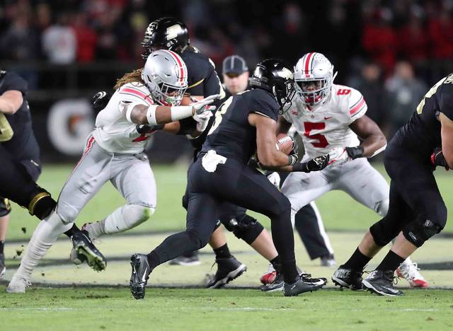Ohio State's Chase Young (left) and Buckeye Baron Browning get pressure in the backfield on Purdue running back Markell Jones (8) in the first quarter at Ross-Ade Stadium on the campus of Purdue University Saturday.