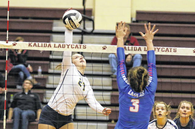 Ottawa Glandorf's Saleigha Ellerbrock hits a spike against Liberty-Benton's Hannah Warrington during Thursday night's Division III district final at Kalida. See more volleyball photos at LimaScores.com.