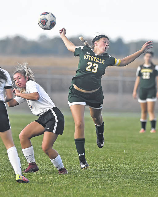 Ottoville's Kasey Knippen plays a header against Continental's Addy Armey during Thursday night's match in Ottoville.