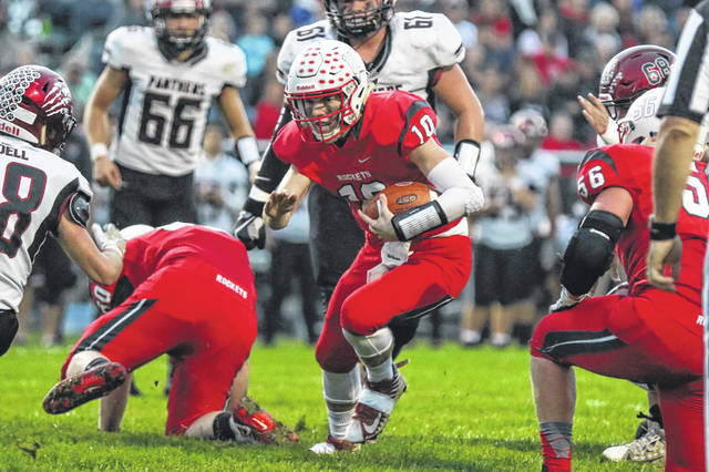 Pandora-Gilboa's Jared Breece finds space to run during Friday night's Blanchard Valley Conference home game against McComb. Breece caught the game-winning touchdown on a trick play and threw for 262 yards and a touchdown.