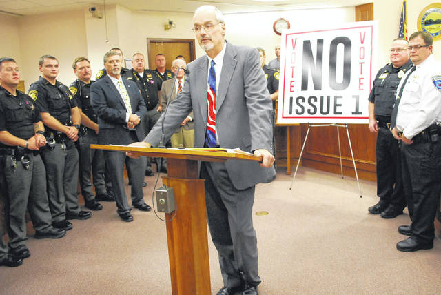 "Allen County Common Pleas Court Judge Jeffrey Reed said state Issue 1, a proposed constitutional amendment which will be decided by voters in the Nov. 6 general election, is a ""dangerous"" piece of legislation that should be rejected by voters. His statements were offered during a show of unity Thursday by legal professionals, law enforcement and elected officials from throughout Allen County."