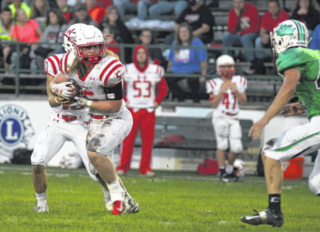 Wapakoneta's Evan Kaeck receives the hand off from quarterback Brady Erb and looks up field during Friday night's Western Buckeye League game at Celina. Kaeck ran for 197 yards on 22 carries and scored three touchdowns.