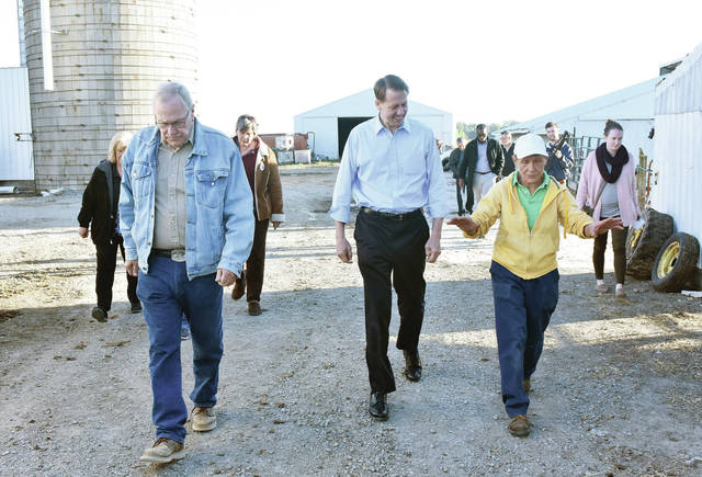Martha Thomas, far right, of Jackson Center, talks with Democratic candidate for governor Rich Cordray, center, and Shelby County Sheriff John Lenhart, during a tour of her farm Thursday, Oct. 18.