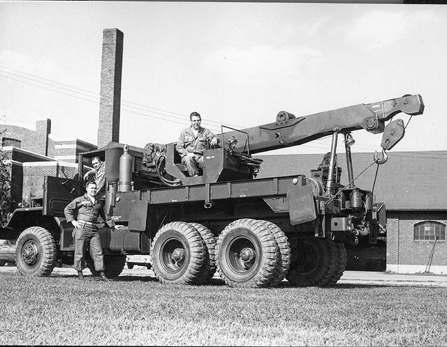 This photo from 1959 shows a wrecking truck with Ohio National Guard soldiers.